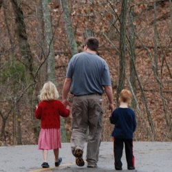 Dad walking with son and daughter