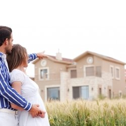 Husband and wife looking at their new home