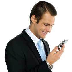 Business professional reading message on smartphone