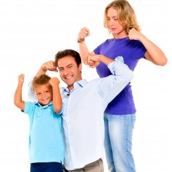 Father, mother and son flexing muscles