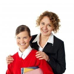 Teacher with girl student holding books