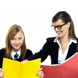Teacher and student holding yellow and red notebooks