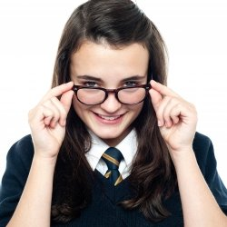 Girl student with geeky glasses smiling