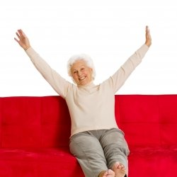 Grandma relaxing on red sofa
