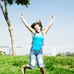 Single girl jumping in joy