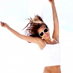 Girl jumping with her arms raised