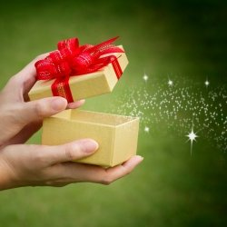 Hands opening gift box