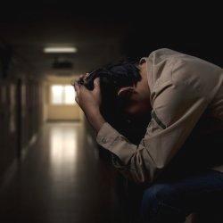 Sad guy in hallway
