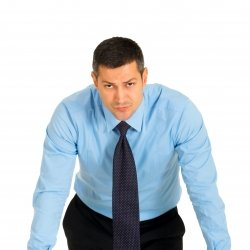Professional businessman leaning towards picture