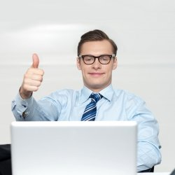 Businessman giving the thumbs up sign