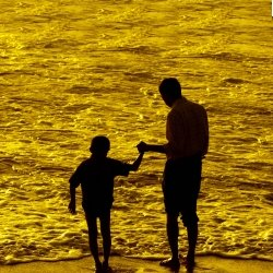 Dad and son at the beach