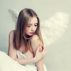 Sad girl with angel like wings