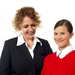 Smiling girl standing with her teacher