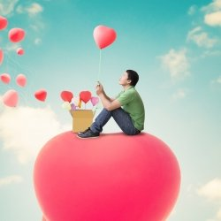 Boy holding a heart balloon