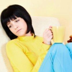 Sad girl holding a coffee mug thumbnail