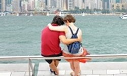 Thumbnail of couple sitting at waterfront